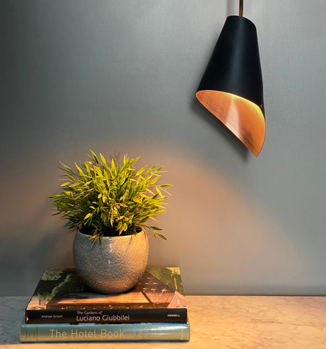 Single pendant light in brushed copper and matte black
