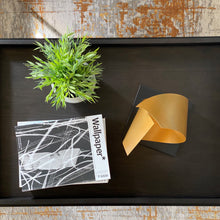 Load image into Gallery viewer, modern gold sculpture on coffee table photographed from above