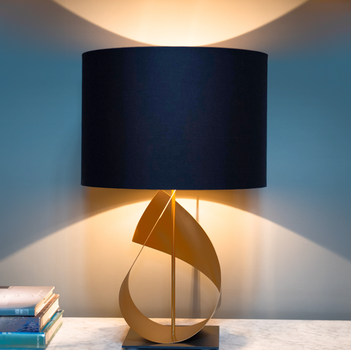 Modern gold table lamp lit - sculptural table lamp