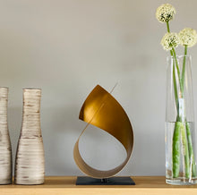 Load image into Gallery viewer, Handcrafted sculpture in gold, modern, contemporary, designer interiors.