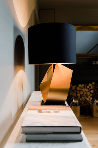 table lamp in gold on console table