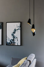 Load image into Gallery viewer, triple pendant light in brushed brass and matte black over sofa