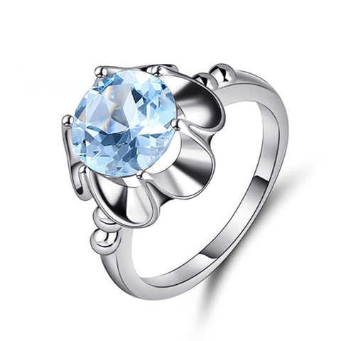 Sterling Silver Elegant Petals Topaz Ring for Woman