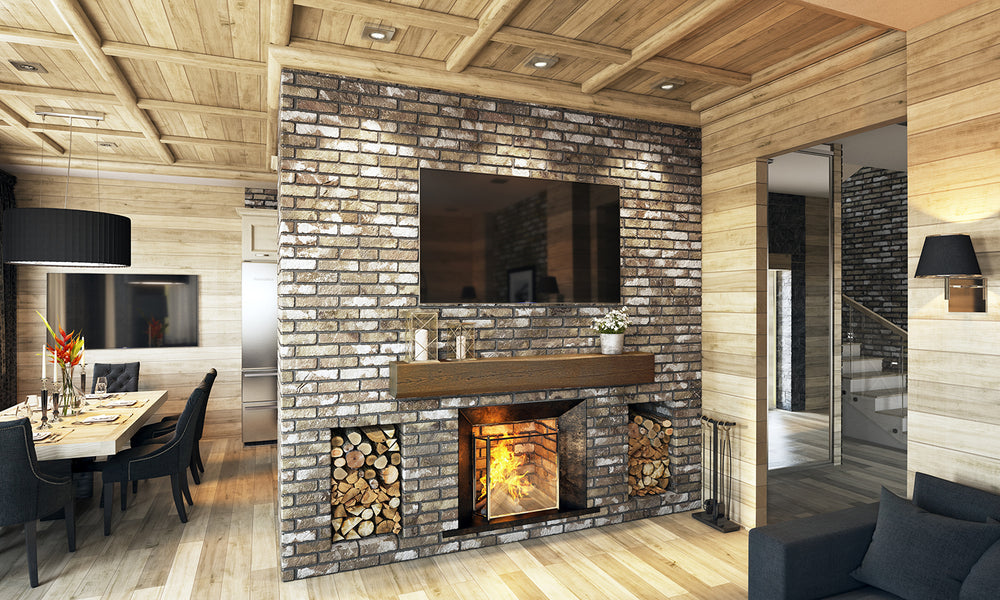 Large Aged Chestnut Hewed Timber non-combustible fireplace mantel in a rustic home setting