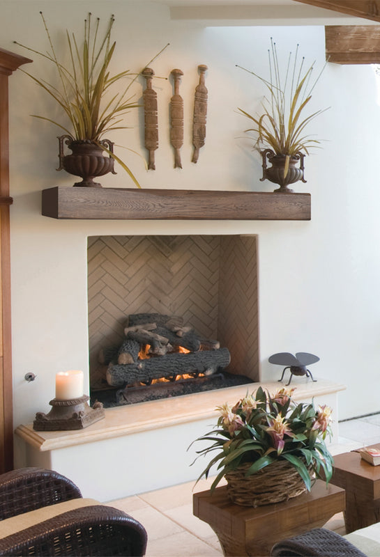 Large Aged Chestnut Hewed Timber non-combustible fireplace mantel in a beautiful outdoor setting