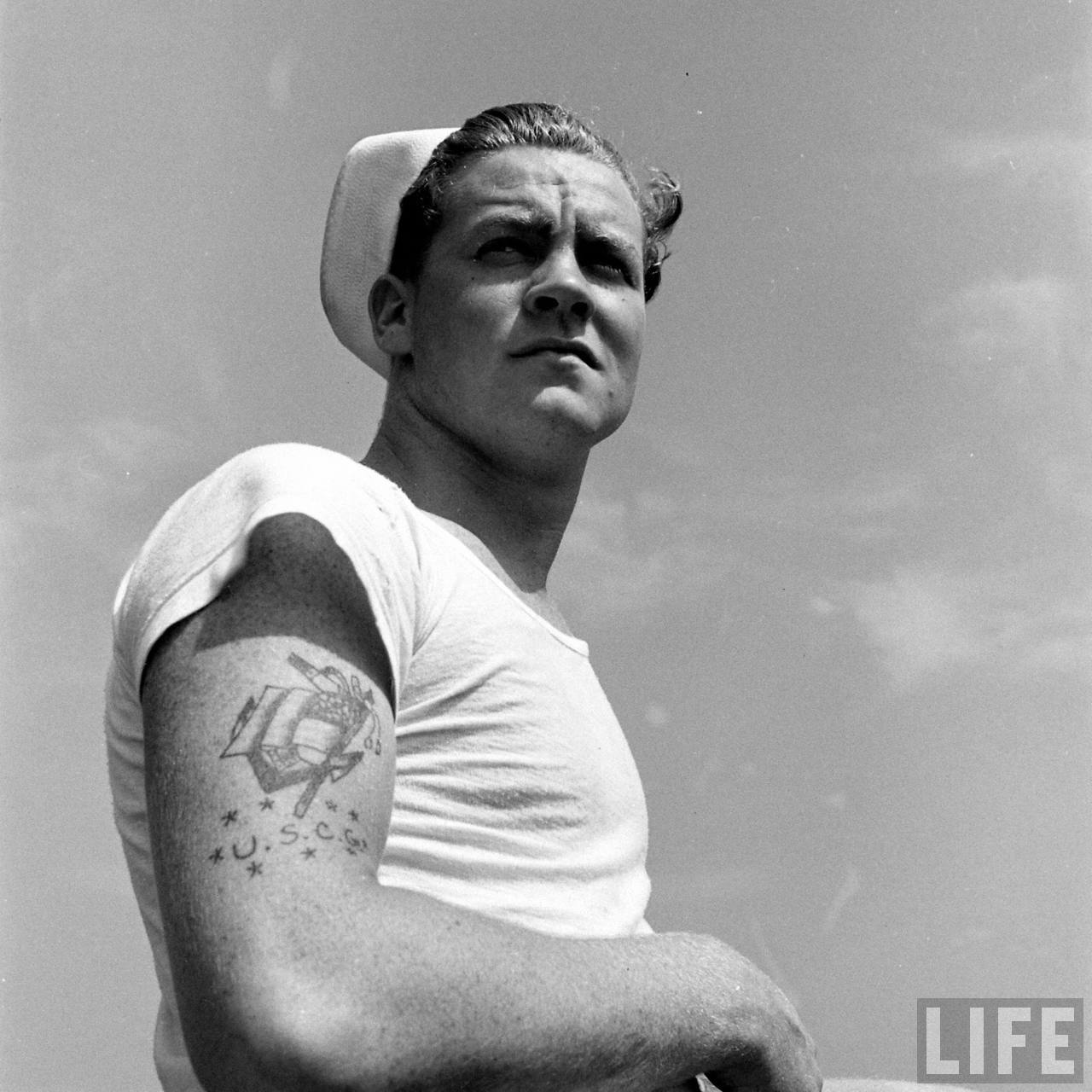 An iconic photo of a US Sailor in a white T-shirt. Photo credit and copyright LIFE magazine
