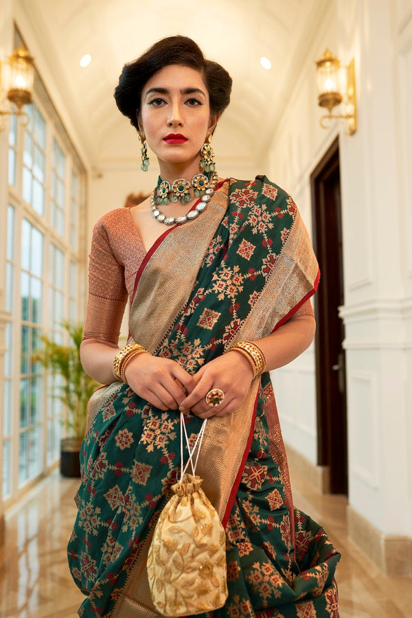 Pine Green Patola Silk Weaving Saree With Contrast Red Zari Detailing Blouse