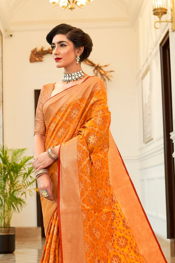 Sunrise Orange Patola Silk Weaving Saree With Contrast Red Zari Detailing Blouse
