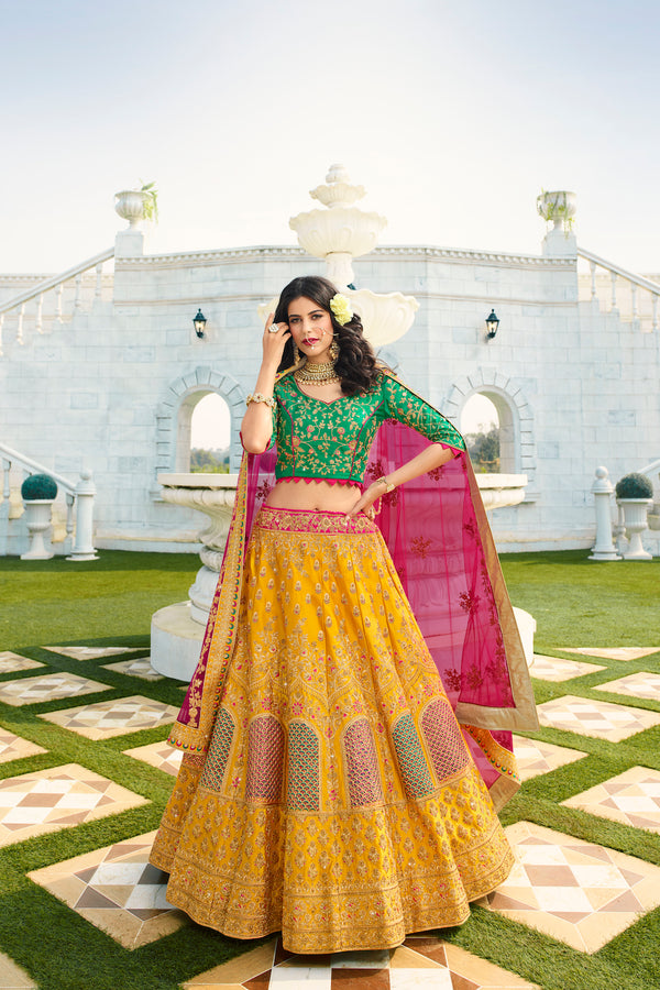 Yellow and Green Heavy Embroidered Silk Designer Lehenga With Magenta Designer Net Dupatta