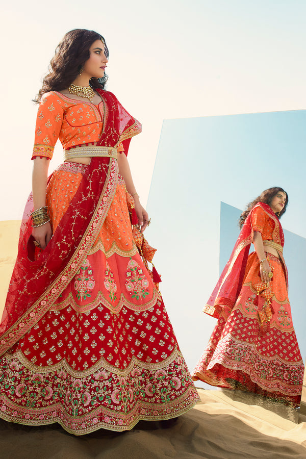 Outstanding Orange and Red Heavy Embroidered Silk Designer Lehenga With Designer Red Net Dupatta