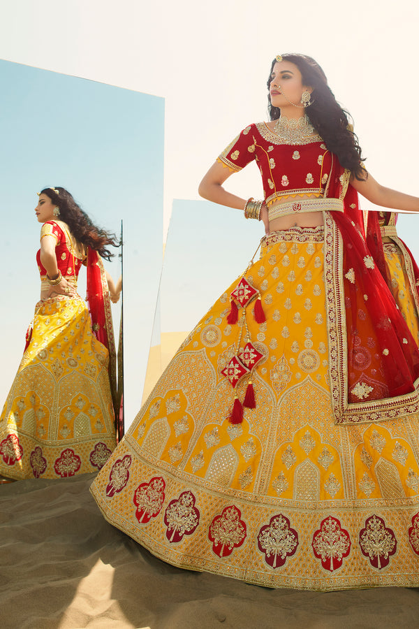 Yellow and Red Heavy Embroidered Silk Designer Lehenga With Designer Red Net Dupatta