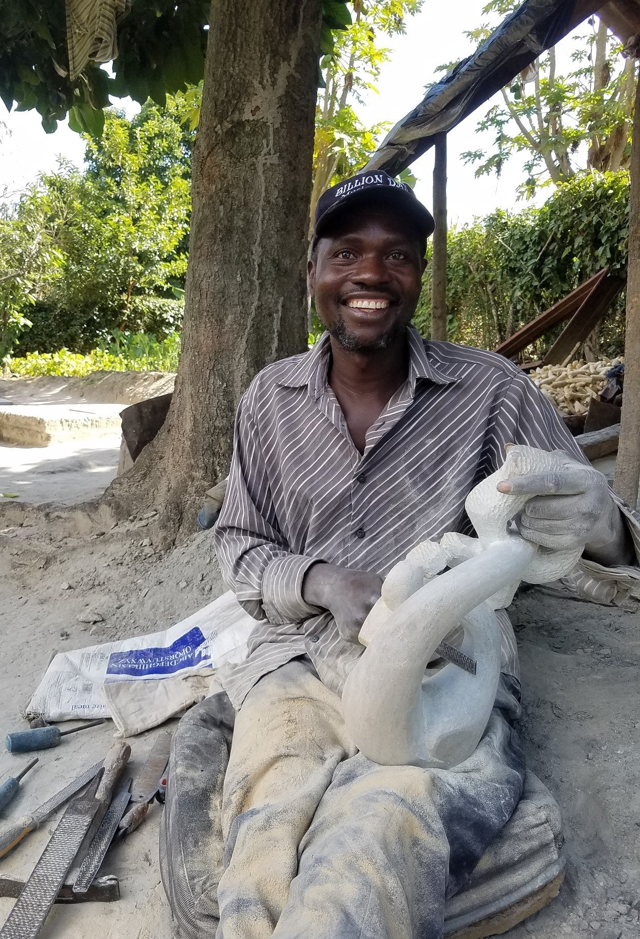 Photo of stone sculptor, Herbert Mwandiringa