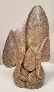 A beautiful abstract sculpture of a mother elephant with her calf was sculpted from a single piece of serpentine stone, in Zimbabwe. The sculpture is completely polished, bringing out the light purplish color of the stone. The design consists of only the frontal view of the heads.