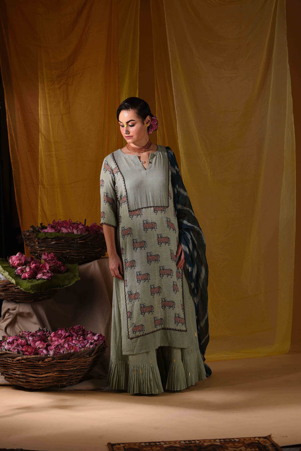 Nandi kurta with pleated sharara and duppata - Monsoon.thedesignerstore