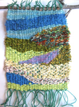 Load image into Gallery viewer, This is a sample from one weaving kit - simple shapes easily woven to suggest a landscape...you can have fun designing your own piece