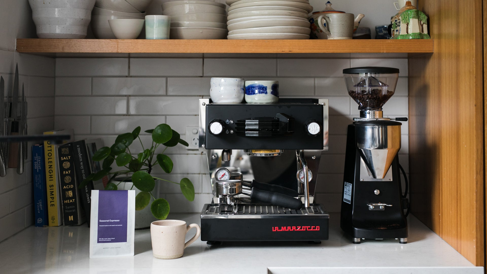 Espresso, espresso machine, mug and coffee beans - a few of the items needed to make great espresso coffee at home using our guide on how to make espresso.