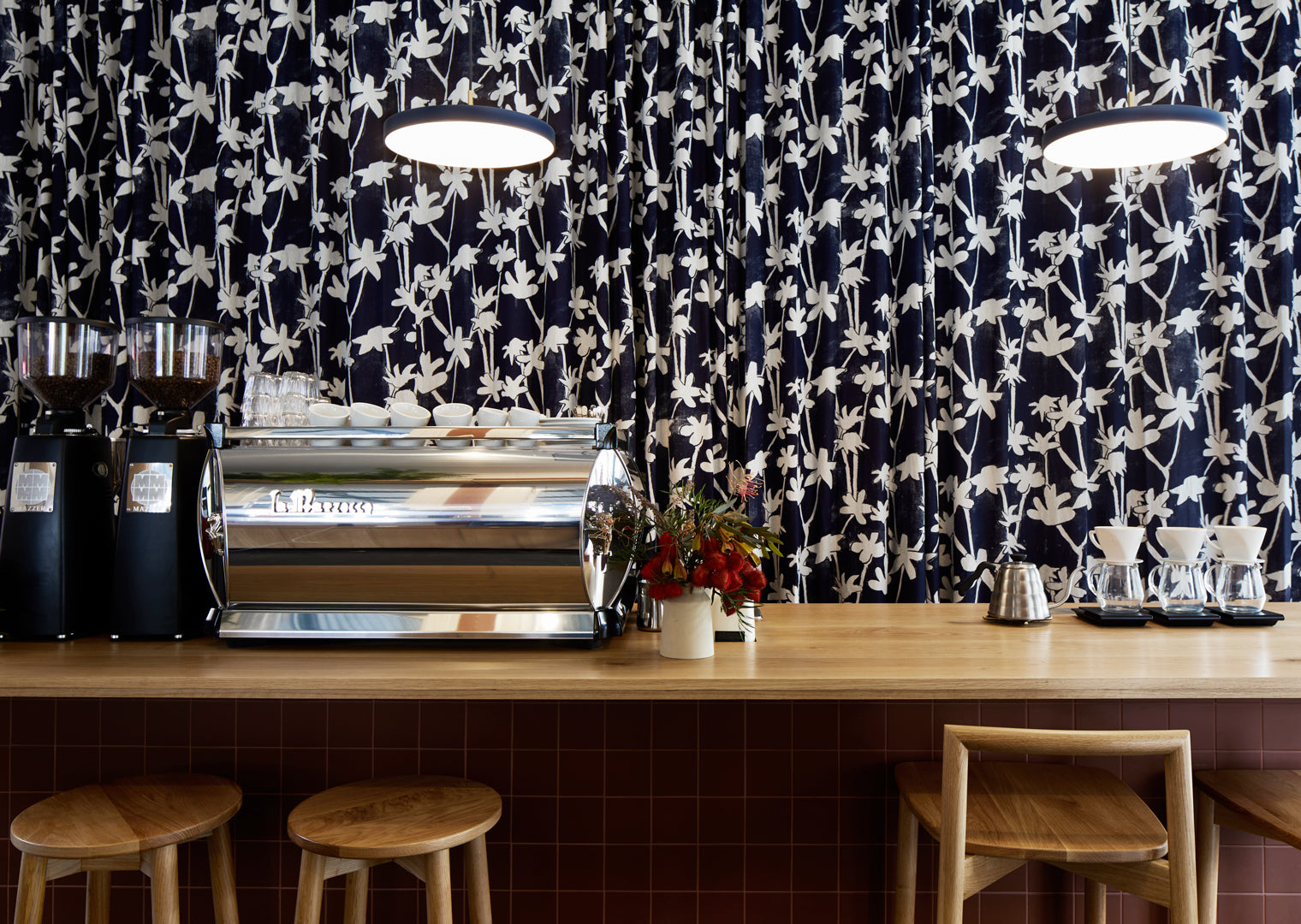 A coffee bar with floral curtains at Market Lane Coffee Shop on Victoria Street