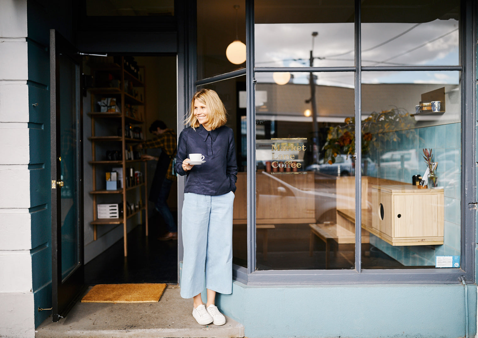 Market Lane Coffee co-founder Fleur Studd enjoying a cup of coffee at Market Lane in South Melbourne.
