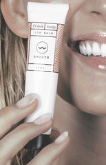 Girl holding lip duo balm tube