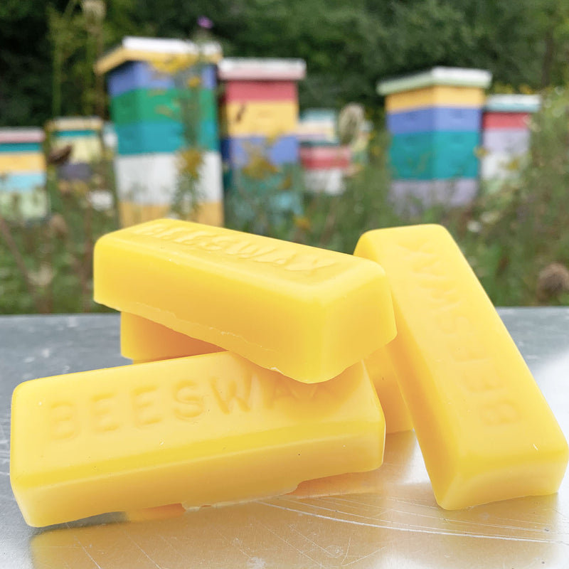 bars of beeswax resting on metal