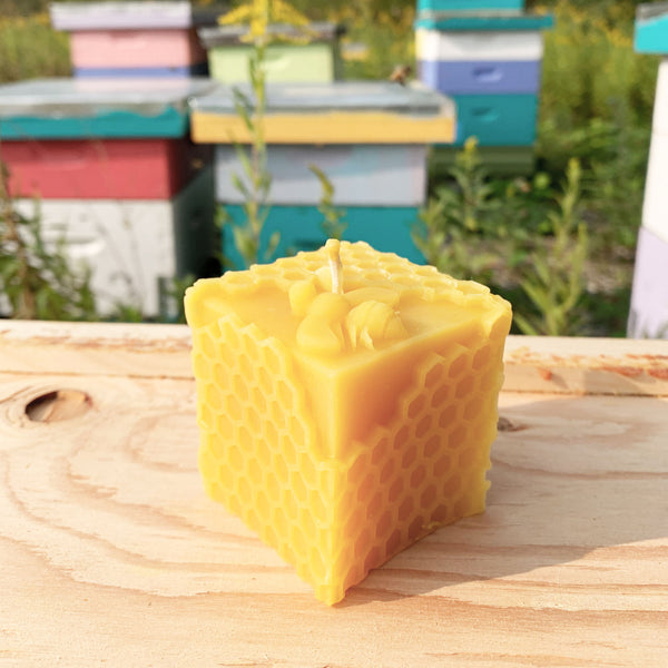 Beeswax cube candle with honeycomb pattern