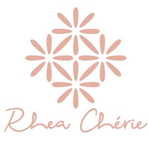 Pink Rhea Cherie logo with white background