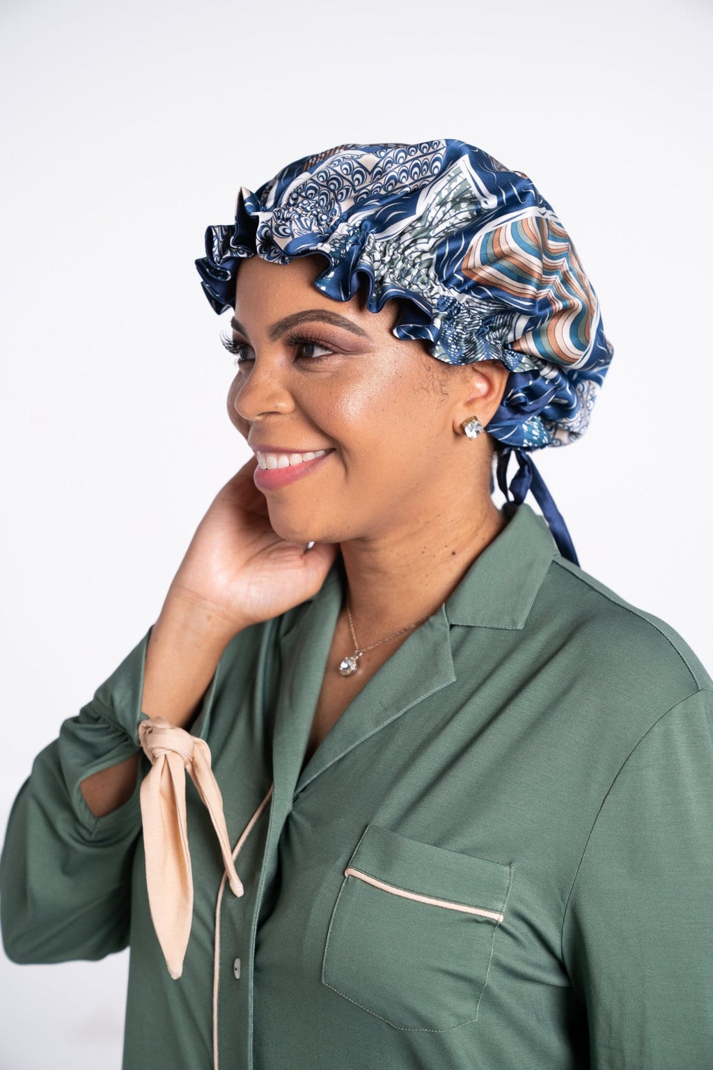 Woman is Rhea Cherie silk bonnet and green modern sleepshirt
