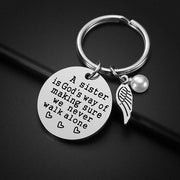 A SISTER IS GOD'S WAY OF MAKING SURE WE NEVER WALK ALONE KEYCHAIN