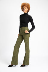 Model is wearing AlekSandraD green tweed wide leg pants