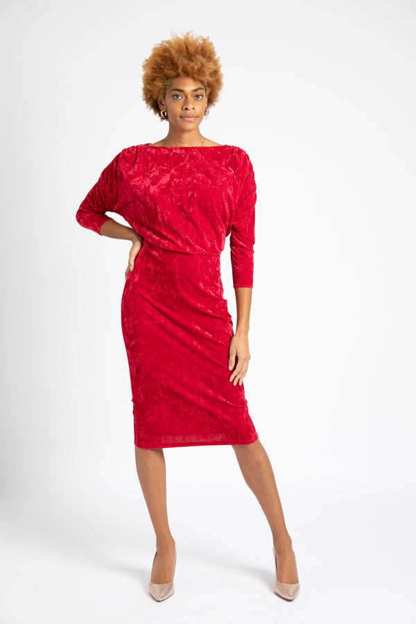 Model is wearing AlekSandraD stretch velvet red pencil dress.