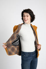 Model is wearing AlekSandraD  wool teddy jacket with contrast lining.