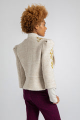 A model is wearing AlekSandraD hand embroidered wool jacket