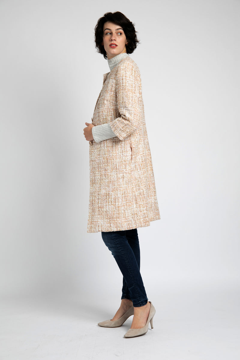 A model is wearing blush-gold tweed coat designed by AlekSandraD.