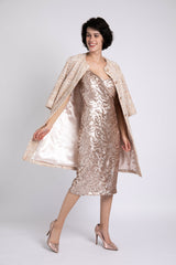 A model is wearing a sequined dress with a blush tweed coat designed by AlekSandraD.