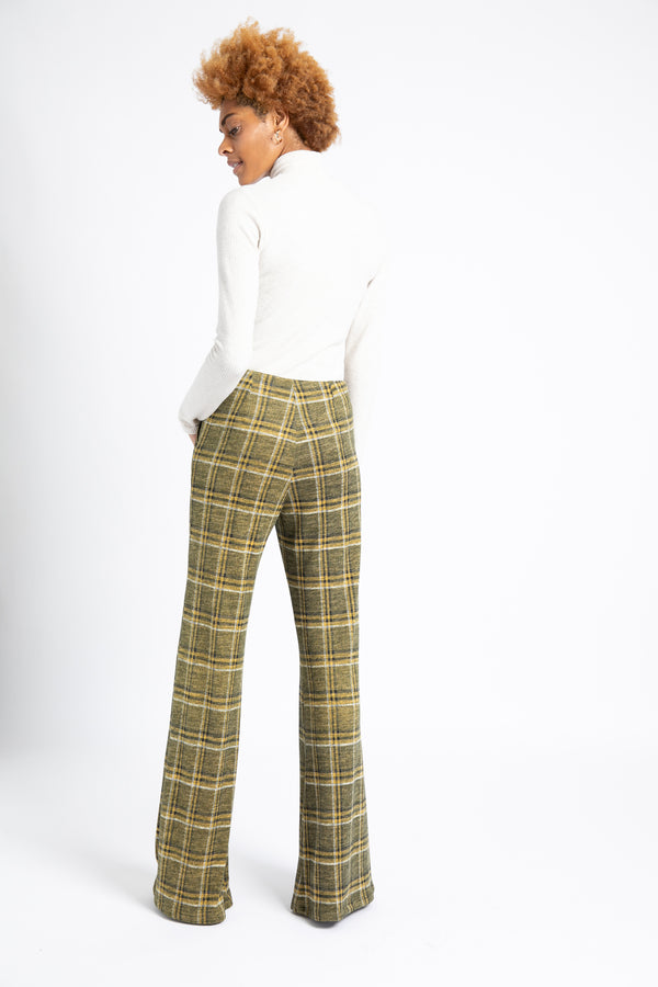 Model is wearing AlekSandraD cozy knit green plaid wide leg  pants