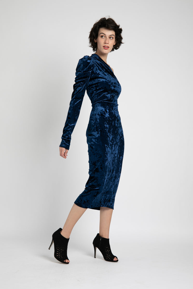 Model is wearing AlekSandraD stretch velvet one sleeve pencil dress.