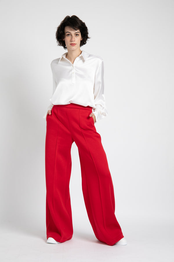 Model is wearing AlekSandraD bright red wide leg winter pants.