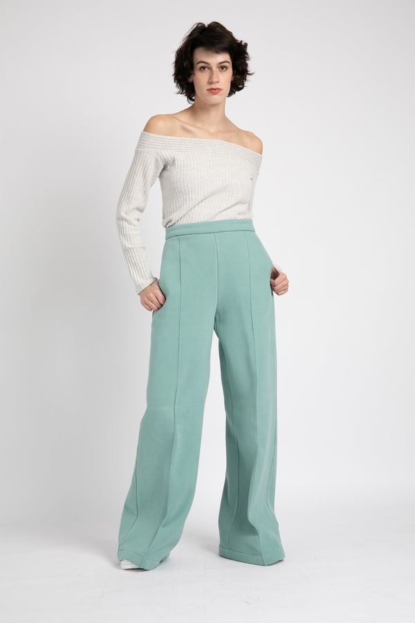Model is wearing AlekSandraD turquoise blue  wide leg winter pants.