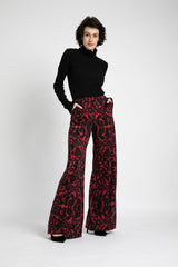 Model is wearing AlekSandraD flower print knit wide leg pants