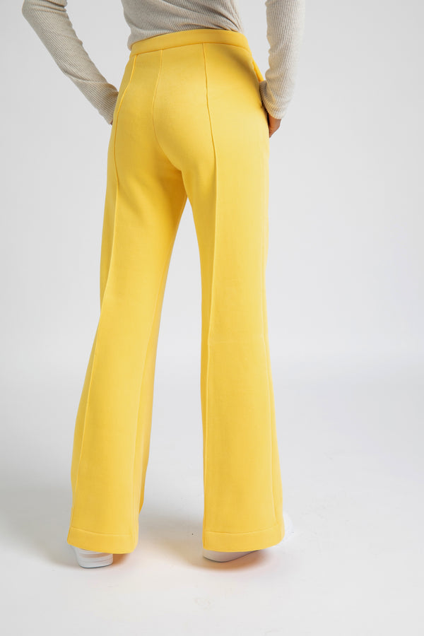 Model is wearing AlekSandraD sunny yellow wide leg winter pants.