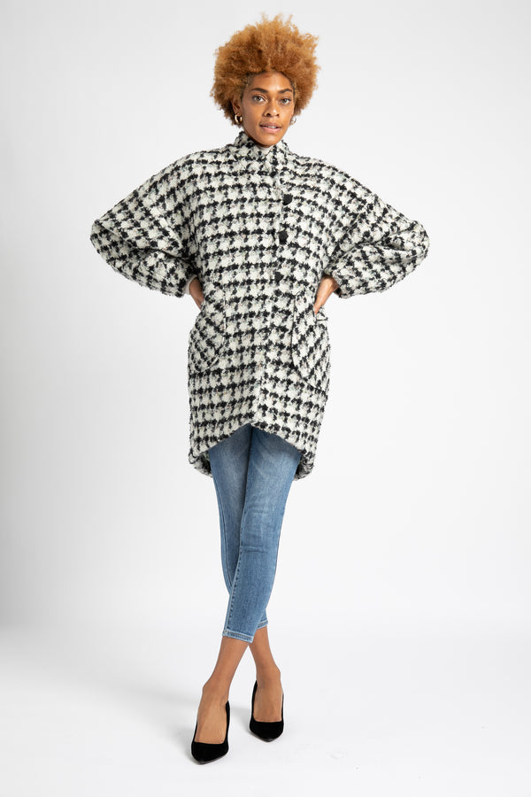 Model is wearing a houndstooth wool cocoon coat designed by AlekSandraD..