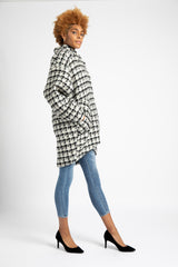 Model is wearing AlekSandraD houndstooth wool cocoon coat.