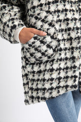Close up of side patch pocket in wool houndstooth coat designed by AlekSandraD.