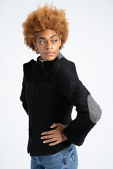 Model is wearing AlekSandraD black short teddy jacket.