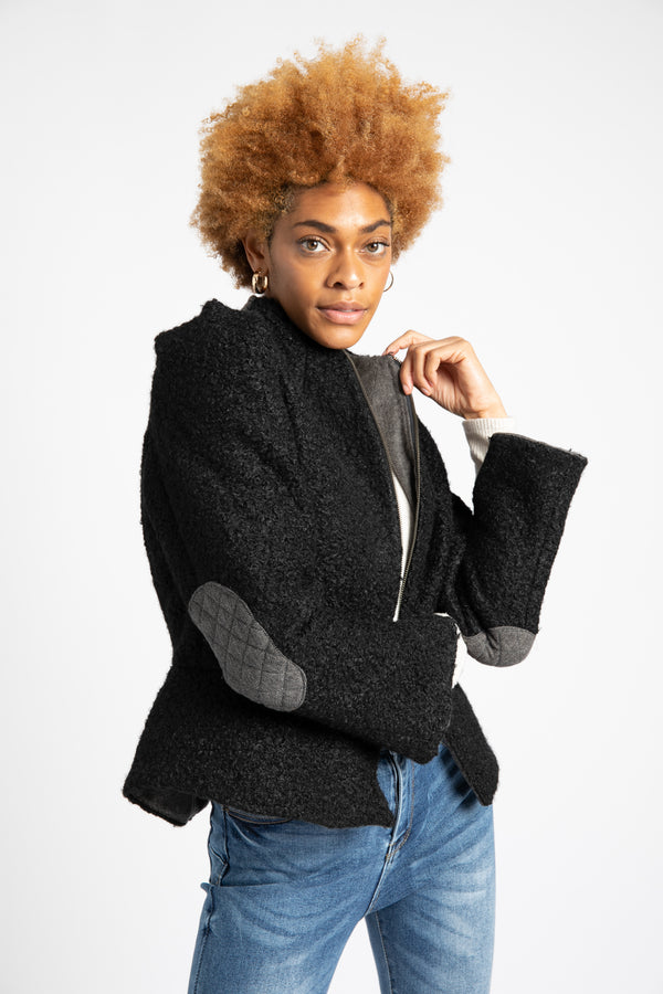 Model is wearing AlekSandraD black short teddy wool jacket.