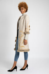 A model is wearing AlekSandraD hand embroidered wool coat.
