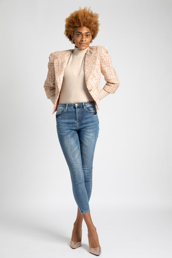 A model is wearing AlekSandaD blush-gold tweed jacket.