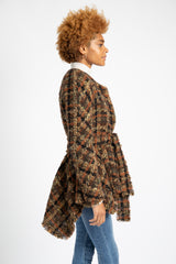 Model is wearing AlekSandraD short brown cashmere coat with self-tie closure.