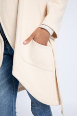 A close up of side patch pocket on off-white sweatshirt coat designed by AlekSandraD.