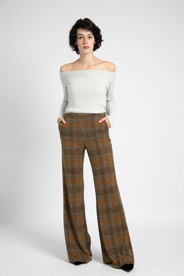 Model is wearing AlekSandraD wide leg mustard plaid knit pants.
